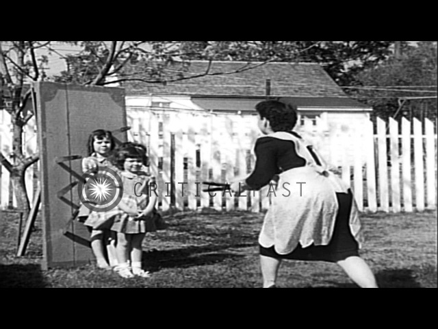 Knife thrower Louella Gallagher with her three daughters in Austin Texas HD Stock Footage