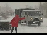 Последствия первого снегопада в Красноярске