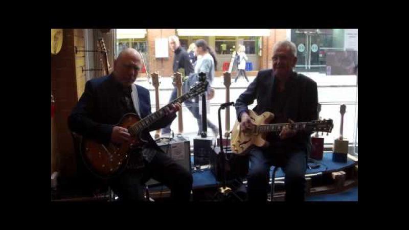 Carl Orr (Billy Cobham) and Jim Mullen playing Lengardo guitars at Ivor Mairants - London - part 1