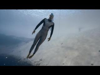 Freediver Anna Von Boetticher swims in Dean's Blue Hole, Bahamas.